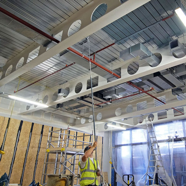 operative spraying a commercial ceiling in london